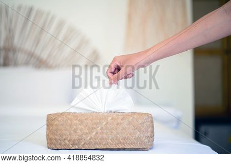 Woman Hands Pulling White Tissue Paper From Wooden Box,protect Your Hands With A Tissue