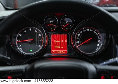 Novosibirsk, Russia - April 25 2021: Opel Astra, Dashboard Of The Car Is Illuminated By Bright Illum
