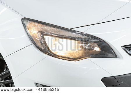 Novosibirsk, Russia - April 25 2021: Opel Astra, Exterior Detail . Close Up  Of Modern  Car Xenon La