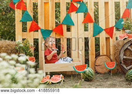 Beautiful Child Having Picnic In Summer. Smiling Little Boy. Caucasian Boy Enjoying Watermelon. Todd