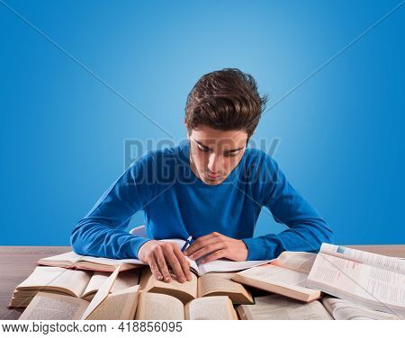 Student Is Studying Hard On The Desk