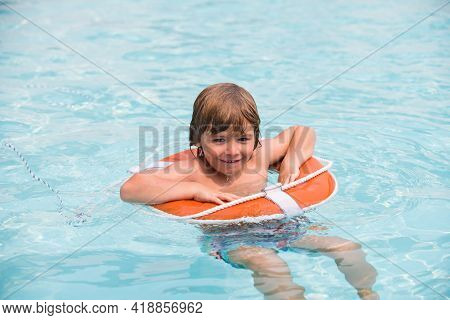 Child In Summer Pool. Happy Kid On Vacations At Seaside. Kid Swimming In Pool. Summer Holidays. Pool