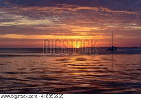 Sailing And Yachting At Sea. Boat On Water At Sunset. Sailboats With Sails. Ocean Water.