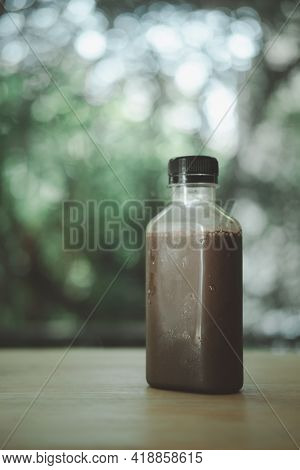 Close Up Cool Mocha Coffee In Plastic Bottle On Wood Table