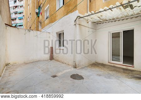 Empty And Old Patio Of Typical Apartment In Barcelona. Worn Out Courtyard On Lowest Floor.