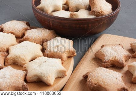 Delicious Homemade Cookies In The Shape Of Stars Sprinkled With Sugar. It Is Laid Out On A Kitchen B