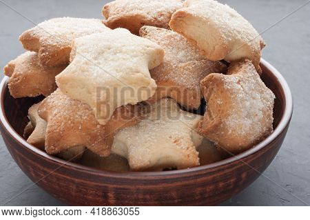 Delicious Homemade Cookies In The Shape Of Stars Sprinkled With Sugar. It Is Laid Out In A Clay Bowl