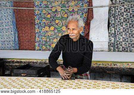 Jaipur, India - Jan 05, 2020: Man Working In A Textile Factory Near Amber Fort In Jaipur, India.