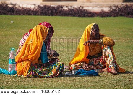 Jaipur, India - Jan 05, 2020: Three Women Sitting In The Grass Near Amber Fort In Jaipur, India.