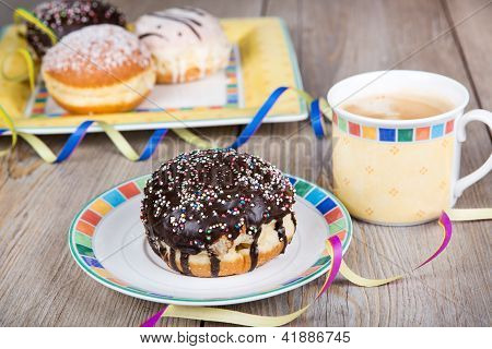 Chocolate And Coconut Donuts With Carnival Decoration.