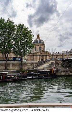 19 June 2019 - Paris, France: The Idyllic Seine River Under Cloudy Summer Sky
