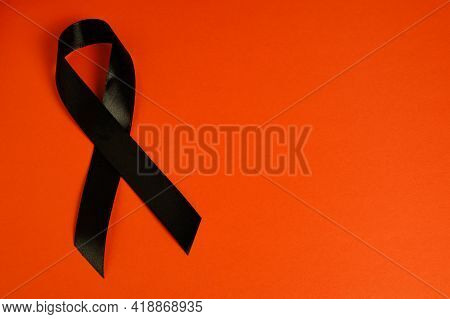 Black Ribbon On Red Background Is Symbol Melanoma, Symbol Of Memory Victims Stalinism And Nazism And