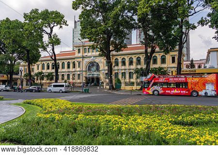 Sightseeing Bus Waiting For Tourists In Front Of Saigon Central Post Office: Ho Chi Minh City, Vietn