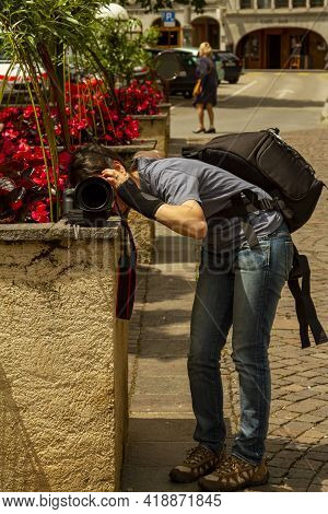 A Photographer Who Does Not Have A Tripod Has Put Her Camera On A Wall And Supported With Bags To Ac