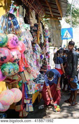 Ella, Sri Lanka - 04 15 2021: Street Vendor And His Toys And Gift Shop Near The Rawana Ella.
