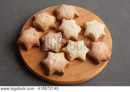 Delicious Homemade Cookies In The Shape Of Stars Sprinkled With Sugar. Laid Out On A Kitchen Board O
