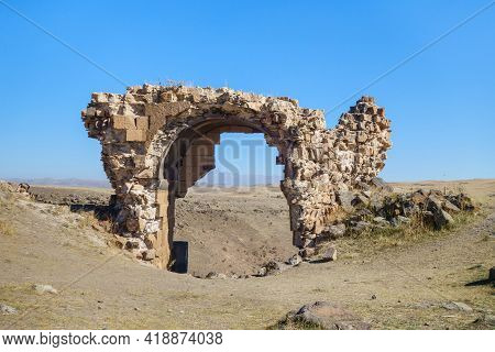 Remains Of Gate's Arch In Medieval Ghost Town Ani, Near Kars, Turkey. Gate Located On Top Of Canyon,