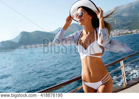 Sexy Healthy Woman Meditating At Serene Tropical Beach And Enjoying Summer Vacation