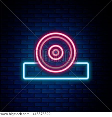 Glowing Neon Line Otolaryngological Head Reflector Icon Isolated On Brick Wall Background. Equipment
