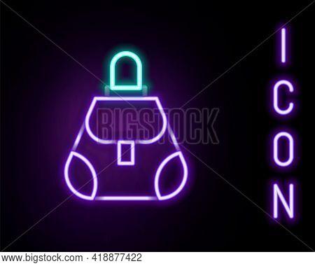 Glowing Neon Line Handbag Icon Isolated On Black Background. Female Handbag Sign. Glamour Casual Bag