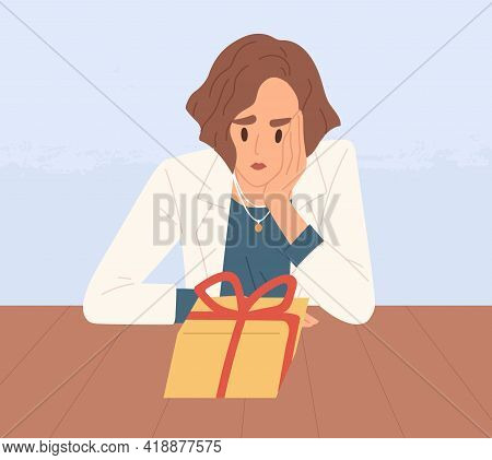 Unhappy Sad Person Looking At Closed Gift Box. Woman Feeling Bad About Unexpected And Unpredictable