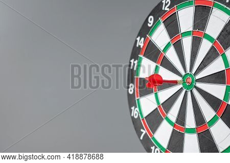 Red Dart Hitting A Target On Center Of Bullseye Or Dartboard. Business, Competition, Goal, Success A