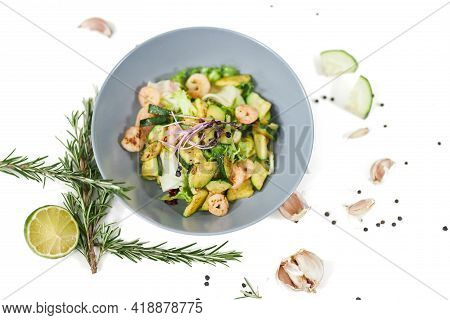 Top View Of Large Modern And Elegant Blue Plate With Appetizing Vegetables Salad With Tasty Juicy Sh