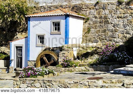 Beautiful And Colorful Waterwheel In Azenhas Do Mar In Lisbon, Portugal. Name Of The Village ,azenha