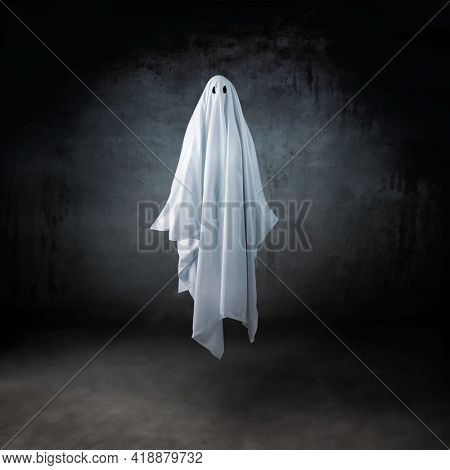 Ghost in a sheet floating in the air