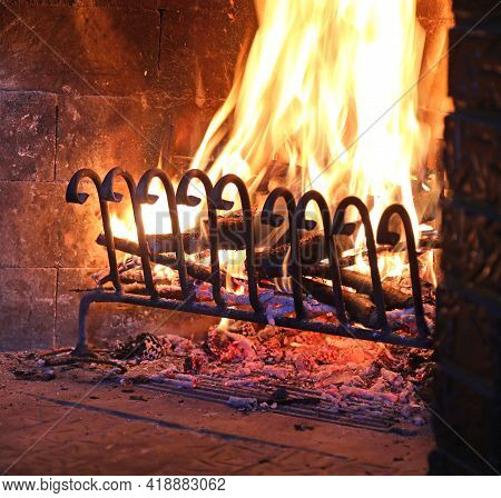 Wide Fireplace With Warm Lit Fire Symbol Of The Warmth Of The Reassuring Abode In Winter