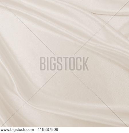 Smooth Elegant Golden Silk Or Satin Luxury Cloth Texture As Wedding Background. Luxurious Background