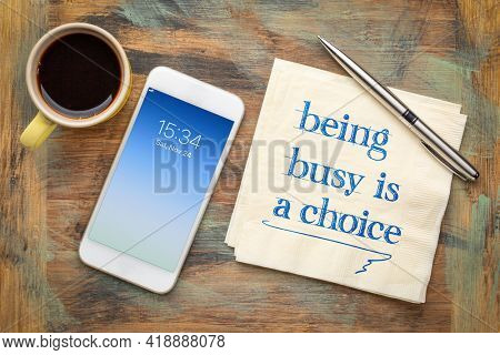 being busy is a choice inspirational reminder - handwriting on napkin with coffee and phone, business, lifestyle and personal development concept