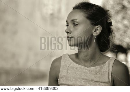 Profile Portrait Of A Young And Beautiful French Woman  With Amazing Eyes In Black And White