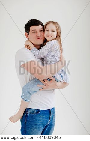 Little Daughter Cuddling And Having Fun With Dad. Happy Family.
