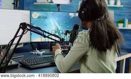 African Streamer Woman Talking With Team Into Headphones