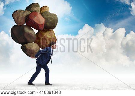 Businessman under burden in business concept