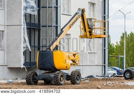 Belarus, Minsk - May 28, 2020: Industrial Vehicle With Lifting Platform Against The Background Of A