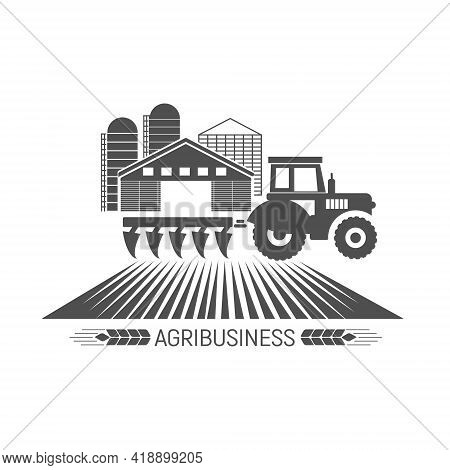 Logo Of An Agricultural Business With A Silhouette Of A Tractor And Agricultural Buildings