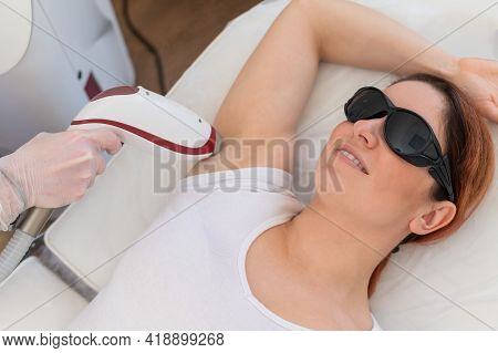Doctor Doing Laser Hair Removal On A Womans Armpit In The Salon. An Alternative Way To Permanently R