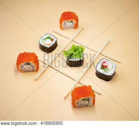 Tic Tac Toe Game With Sushi On Orange Background, Creative Concept Sushi Rolls. Playing Tic Tac Toe