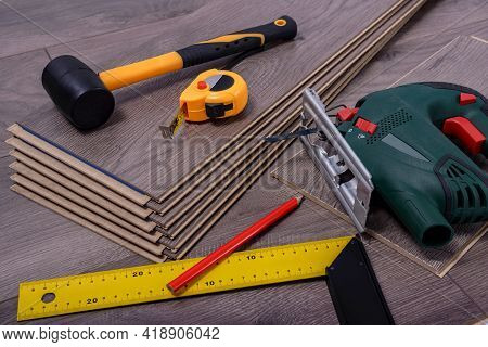 Equipment Or Tools To Install Laminate Floor, Rubber Hammer, Electric Jig Saw, Pencil And Metre. Sel