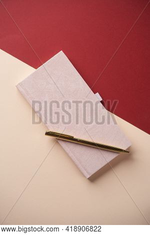 Education Concept With Notebook And Pen On Color Background