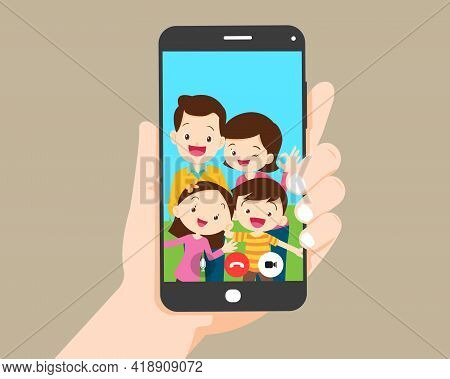 Hand Hold Smartphone Video Call With Family.family Call Concept. Young Family With  Kids Are Having