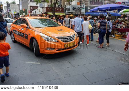 Seoul, South Korea - 1 June 2014, The Orange Taxi Is Driven In The Holiday Walking Street Event, Seo