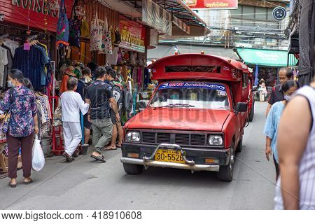 Chiang Mai, Thailand - 18 Oct 2020, Red Traditional Taxi Truck Is Driving Around Kad Luang, Warorot
