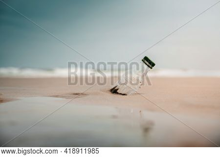 Environment, Ecology Care, Renewable Concept. Plastic Bottle Waste On The Beach Sand