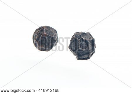 Two Black Pepper Grains Isolated On White Bacground. Heap Of Dry Peppercorn Spice. Black Pepper Seed