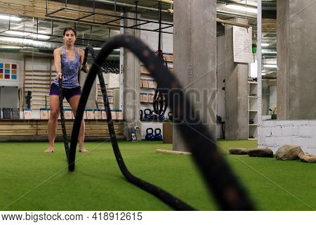 Sporty Woman Doing Functional Training By Shaking The Ropes In The Gym, Active And Sporty Lifestyle