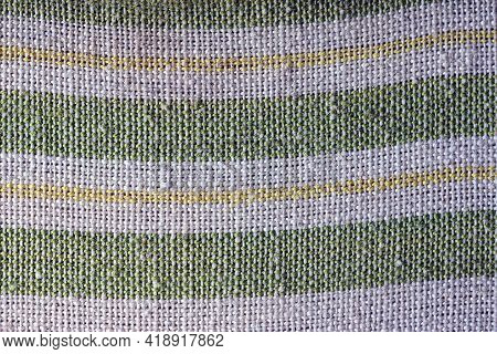 Colored Fabric Texture From A Piece Of Gray Cloth With Green And Yellow Stripes