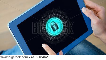 Close up of tablet with padlock graphic on screen, held by caucasian woman. global technology, data processing and digital interface concept digitally generated image.